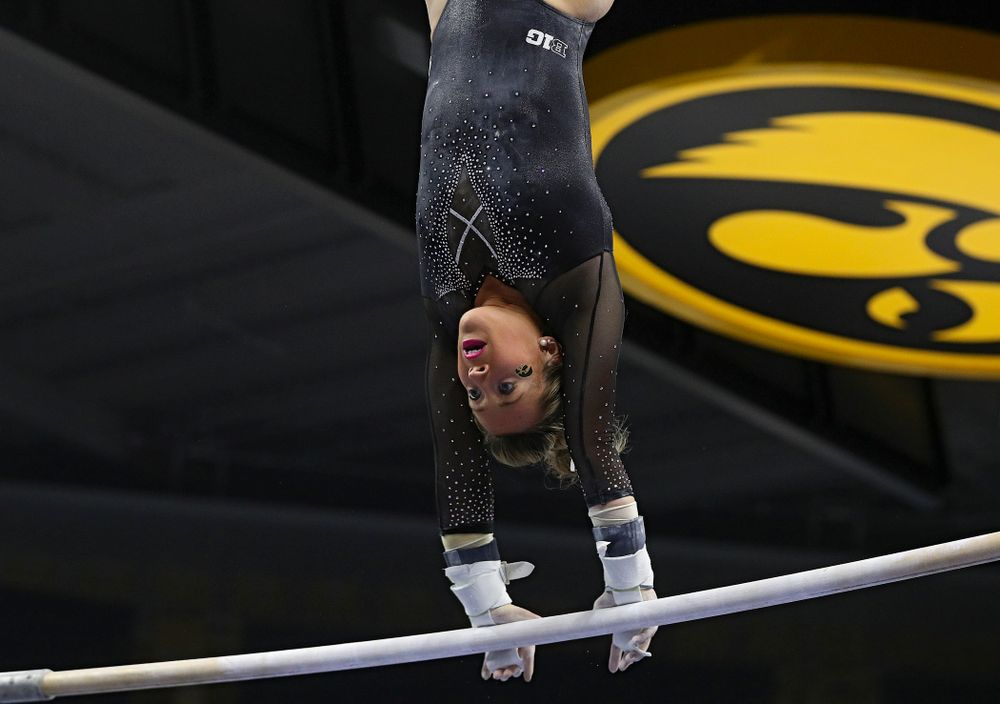 Iowa's Maddie Kampschroder competes on the bars during their meet at Carver-Hawkeye Arena in Iowa City on Sunday, March 8, 2020. (Stephen Mally/hawkeyesports.com)