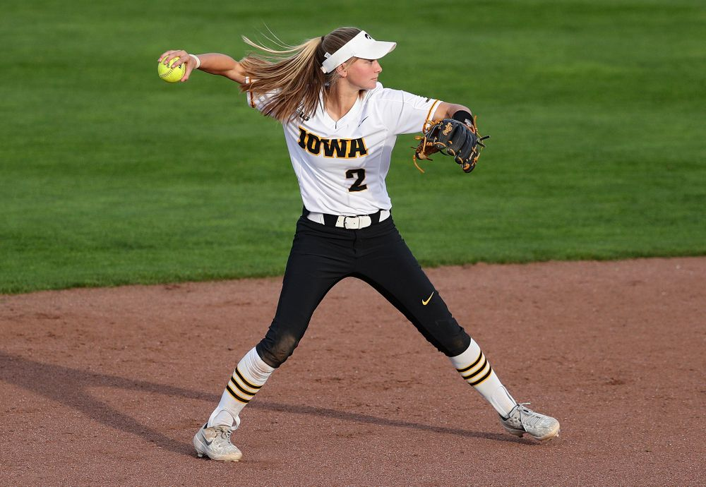 Iowa second baseman Aralee Bogar (2) throws to first for an out during the fifth inning of their game against Ohio State at Pearl Field in Iowa City on Friday, May. 3, 2019. (Stephen Mally/hawkeyesports.com)