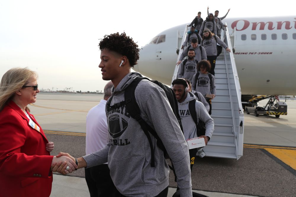 Iowa Hawkeyes defensive back Julius Brents (20) shakes hands with the ÒRed CoatsÓ after arriving in San Diego, CA Saturday, December 21, 2019 for the Holiday Bowl. (Brian Ray/hawkeyesports.com)