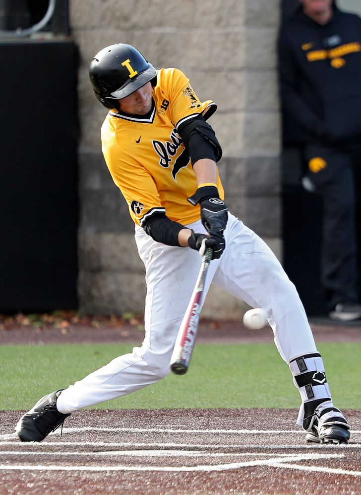 Iowa catcher Brett McCleary (32) drives a pitch for a hit during the third inning of the first game of the Black and Gold Fall World Series at Duane Banks Field in Iowa City on Tuesday, Oct 15, 2019. (Stephen Mally/hawkeyesports.com)