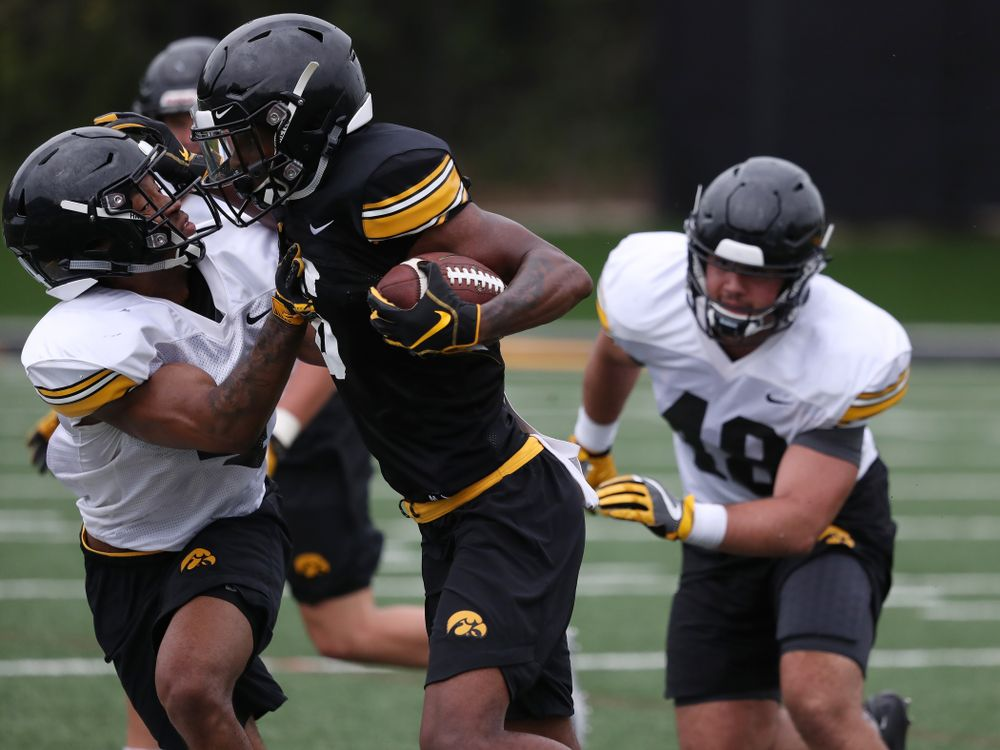 Iowa Hawkeyes wide receiver Ihmir Smith-Marsette (6) and defensive back Josh Turner (4) during practice No. 4 of Fall Camp Monday, August 6, 2018 at the Hansen Football Performance Center. (Brian Ray/hawkeyesports.com)