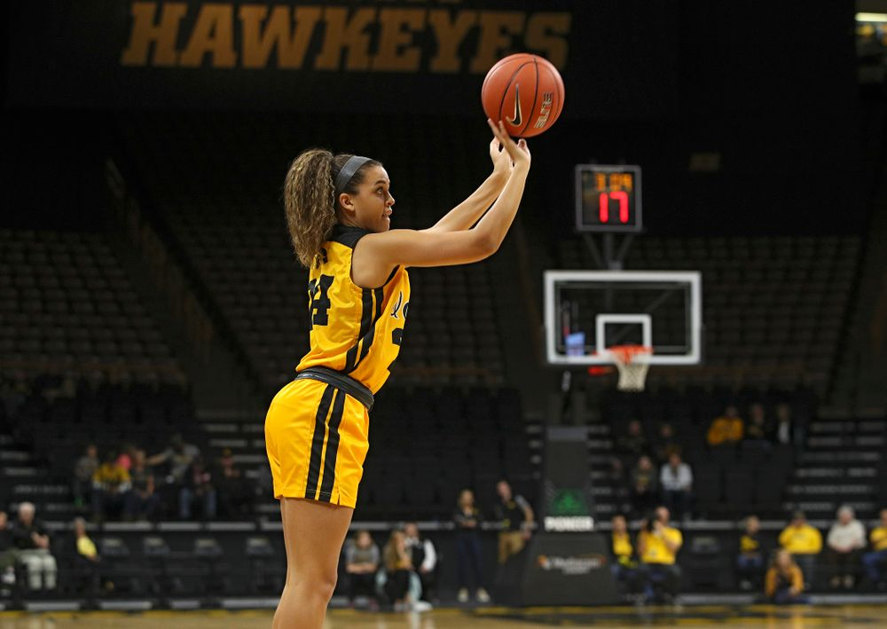 Iowa guard Gabbie Marshall (24) puts up a shot during the first quarter of their game against Winona State at Carver-Hawkeye Arena in Iowa City on Sunday, Nov 3, 2019. (Stephen Mally/hawkeyesports.com)
