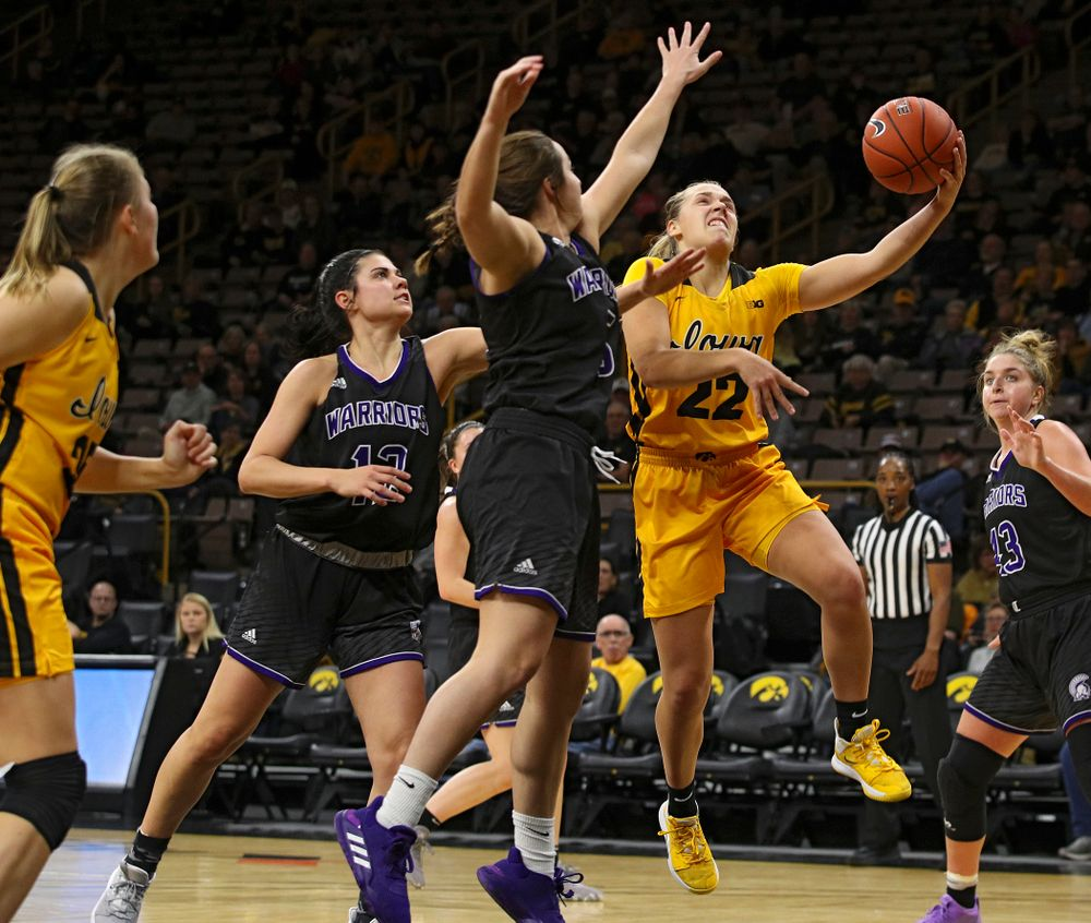 Iowa guard Kathleen Doyle (22) puts up a shot during the second quarter of their game against Winona State at Carver-Hawkeye Arena in Iowa City on Sunday, Nov 3, 2019. (Stephen Mally/hawkeyesports.com)