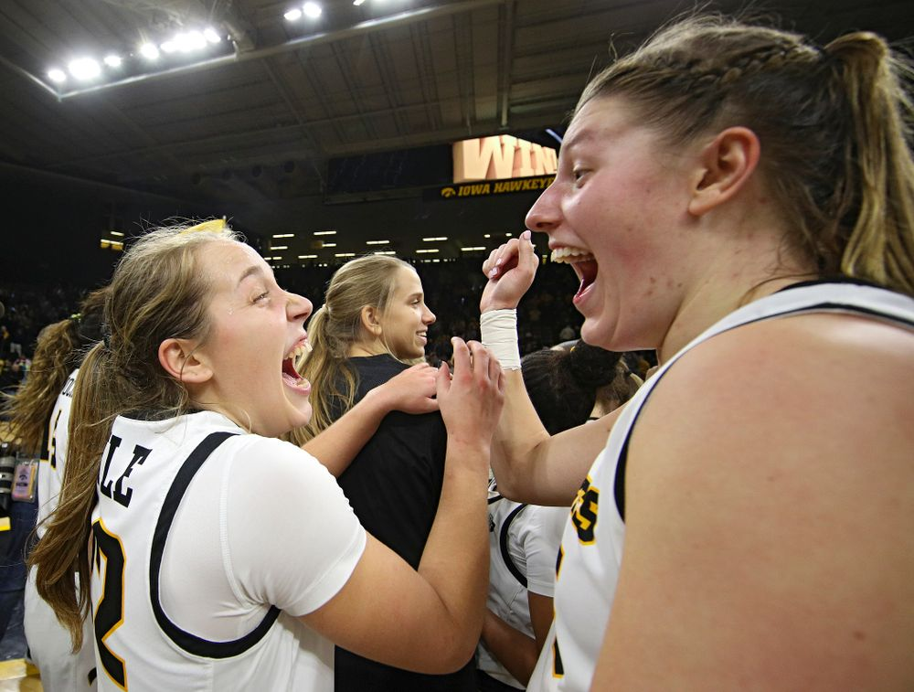 Iowa Hawkeyes guard Kathleen Doyle (22) shares a laugh with forward Monika Czinano (25) after winning their game at Carver-Hawkeye Arena in Iowa City on Thursday, February 6, 2020. (Stephen Mally/hawkeyesports.com)