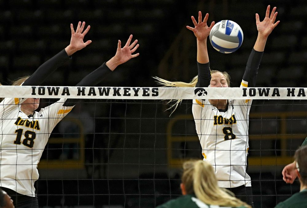 Iowa's Kyndra Hansen (8) blocks a shot during the second set of their volleyball match at Carver-Hawkeye Arena in Iowa City on Sunday, Oct 13, 2019. (Stephen Mally/hawkeyesports.com)