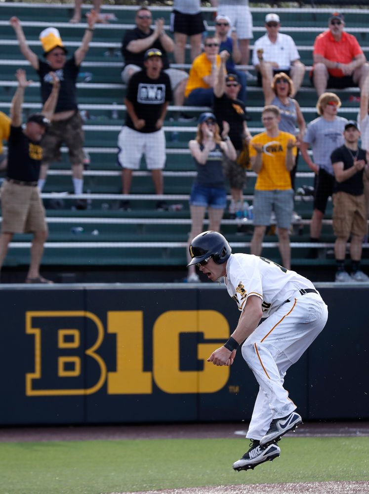 Iowa Hawkeyes catcher Austin Guzzo (20) celebrates after scoring against the Oklahoma State Cowboys Saturday, May 5, 2018 at Duane Banks Field. (Brian Ray/hawkeyesports.com)