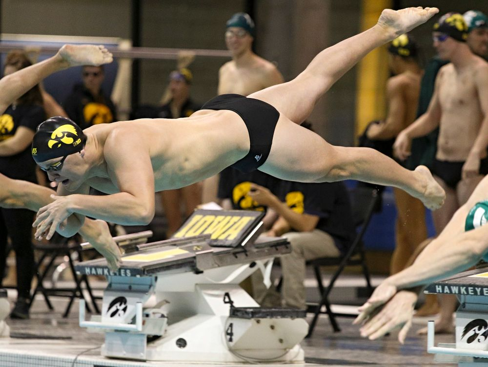 Iowa's Will Myhre takes off for the 100-yard individual medley event during their meet against Michigan State at the Campus Recreation and Wellness Center in Iowa City on Thursday, Oct 3, 2019. (Stephen Mally/hawkeyesports.com)