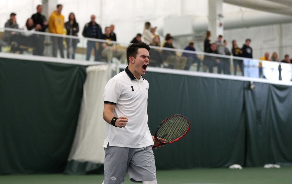 Iowa's Jonas Larson celebrates after winning a doubles match with Kareem Allaf against Western Michigan Saturday, January 19, 2019 at the Hawkeye Tennis and Recreation Complex. (Brian Ray/hawkeyesports.com)
