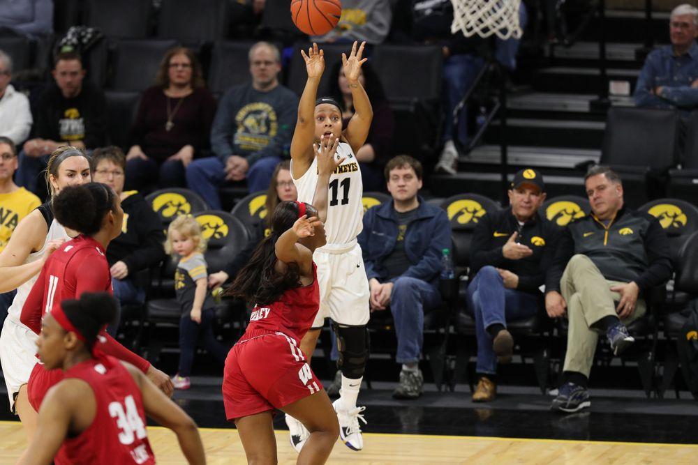 Iowa Hawkeyes guard Tania Davis (11) against the Wisconsin Badgers Monday, January 7, 2019 at Carver-Hawkeye Arena.  (Brian Ray/hawkeyesports.com)