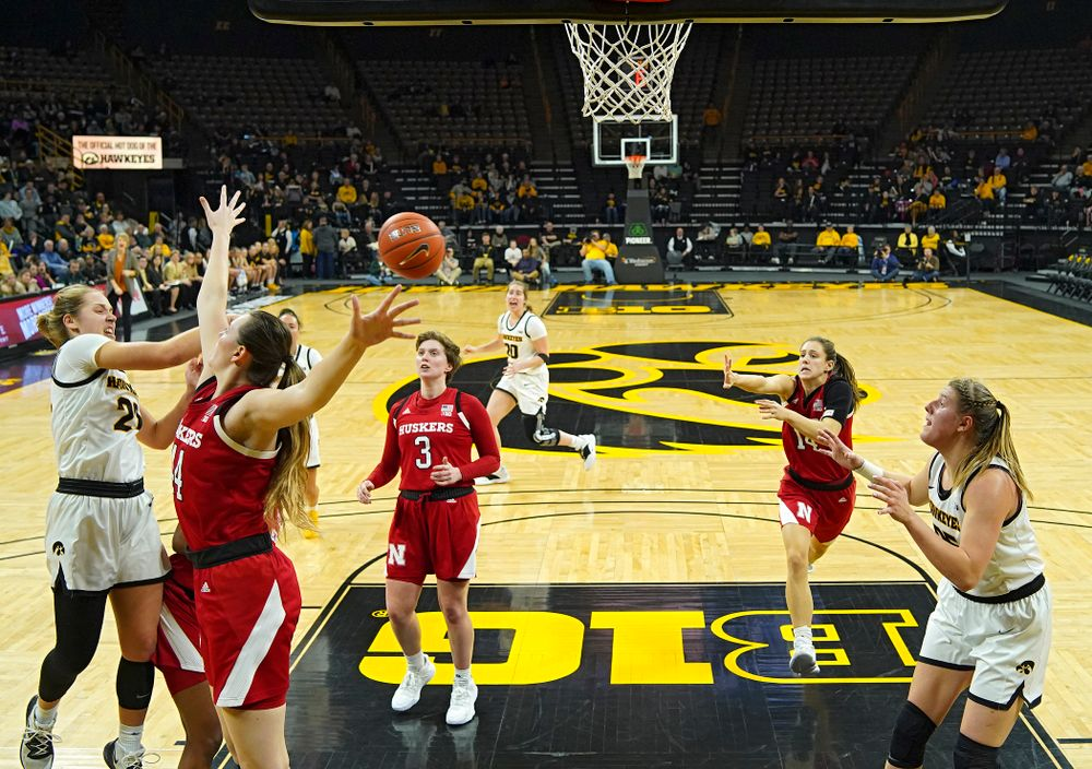 Iowa Hawkeyes guard Kathleen Doyle (22) passes the ball to forward Monika Czinano (25) for an assist as Czinano scores during the second quarter of the game at Carver-Hawkeye Arena in Iowa City on Thursday, February 6, 2020. (Stephen Mally/hawkeyesports.com)