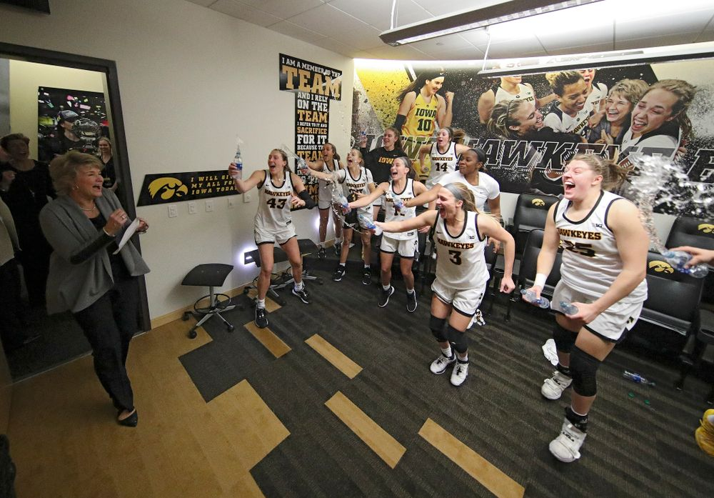 The Hawkeyes sprays head coach Lisa Bluder with water as she enters the locker room after their double overtime win at Carver-Hawkeye Arena in Iowa City on Sunday, January 12, 2020. (Stephen Mally/hawkeyesports.com)