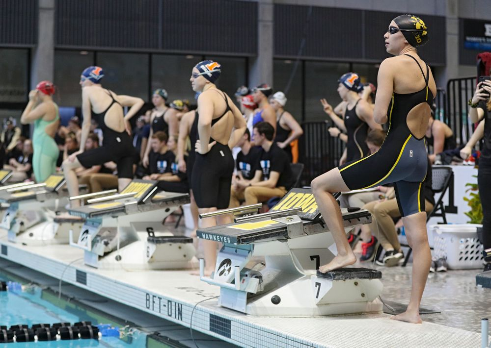 Iowa's Meghan Hackett waits to swim in the women's 100 yard freestyle preliminary event during the 2020 Women's Big Ten Swimming and Diving Championships at the Campus Recreation and Wellness Center in Iowa City on Saturday, February 22, 2020. (Stephen Mally/hawkeyesports.com)