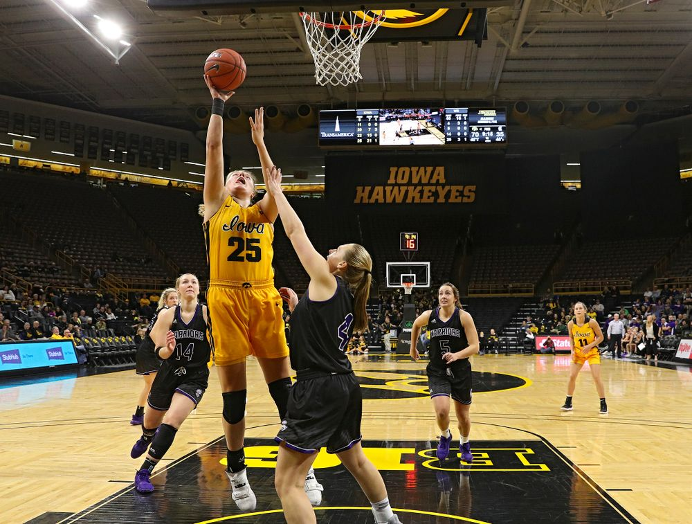 Iowa forward/center Monika Czinano (25) makes a basket during the fourth quarter of their game against Winona State at Carver-Hawkeye Arena in Iowa City on Sunday, Nov 3, 2019. (Stephen Mally/hawkeyesports.com)