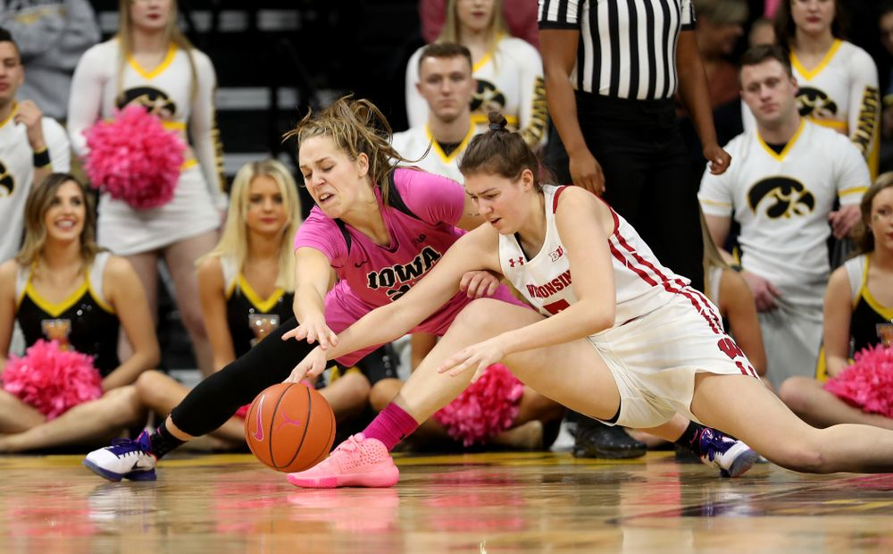 Iowa Hawkeyes guard Kathleen Doyle (22) battles for a loose ball against the Wisconsin Badgers Sunday, February 16, 2020 at Carver-Hawkeye Arena. (Brian Ray/hawkeyesports.com)