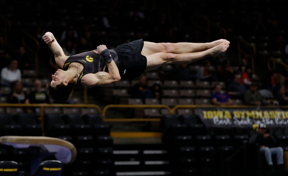 Mark Springett competes on the floor against Illinois