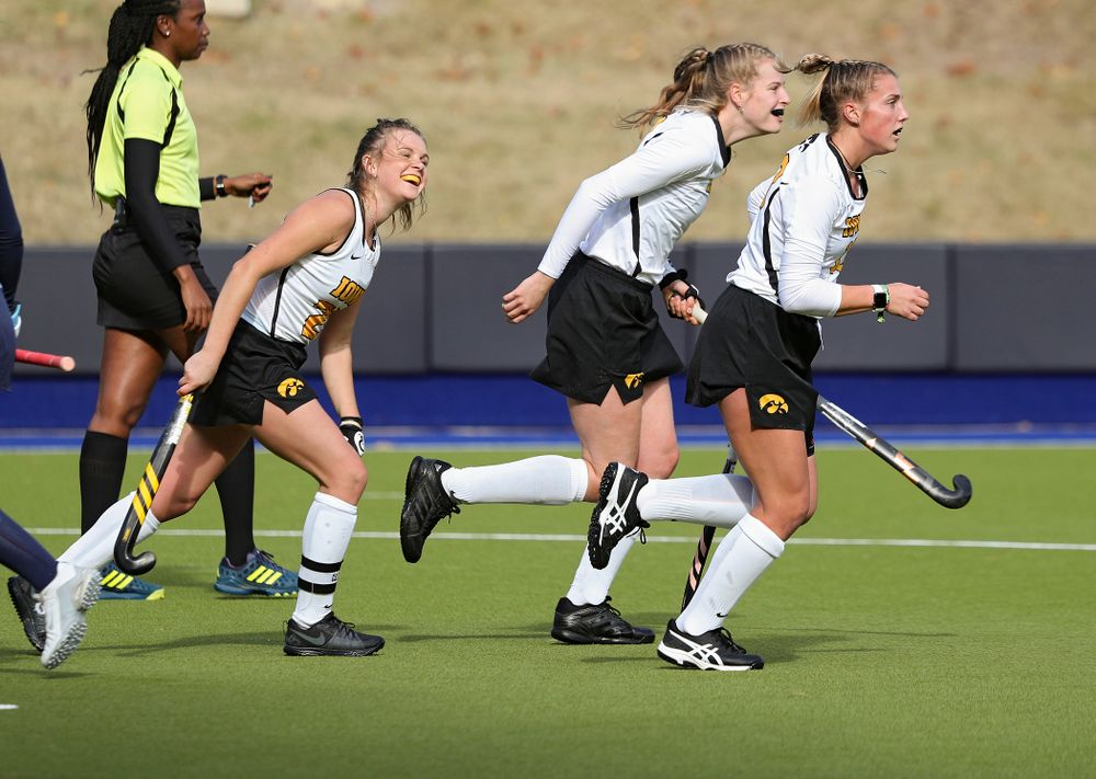 Iowa's Maddy Murphy (26), Sofie Stribos (9), and Leah Zellner (13) celebrate after Stribos' goal during the second quarter of their NCAA Tournament Second Round match against North Carolina at Karen Shelton Stadium in Chapel Hill, N.C. on Sunday, Nov 17, 2019. (Stephen Mally/hawkeyesports.com)