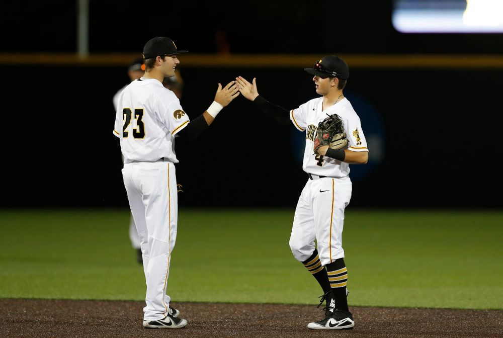 Iowa Hawkeyes infielder Kyle Crowl (23) and infielder Mitchell Boe (4) against the Penn State Nittany Lions  Thursday, May 17, 2018 at Duane Banks Field. (Brian Ray/hawkeyesports.com)