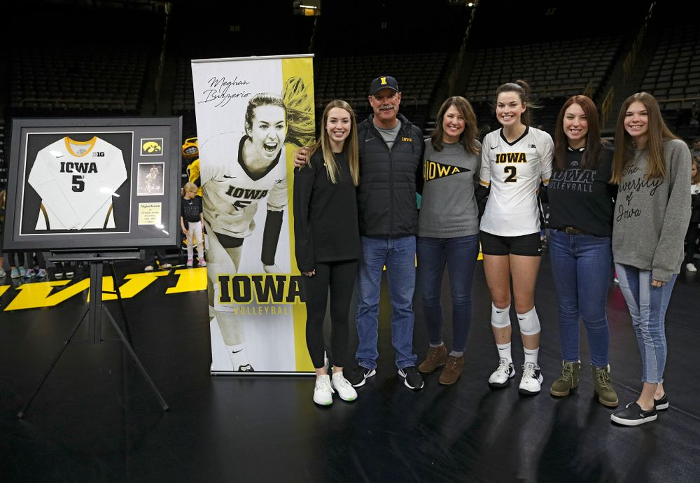 Iowa's Meghan Buzzerio (5) is honored with her family on Senior Day before their match at Carver-Hawkeye Arena in Iowa City on Saturday, Nov 30, 2019. (Stephen Mally/hawkeyesports.com)