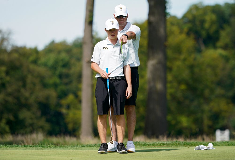 Iowa's Matthew Garside (from left) talks with head coach Tyler Stith during the second day of the Golfweek Conference Challenge at the Cedar Rapids Country Club in Cedar Rapids on Monday, Sep 16, 2019. (Stephen Mally/hawkeyesports.com)
