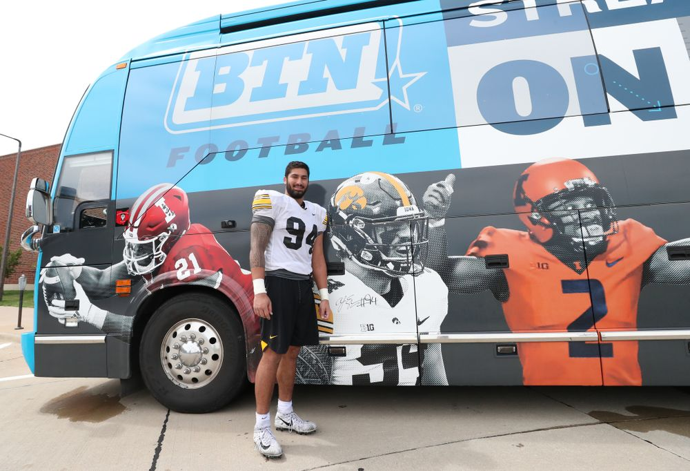 DL AJ Epenesa (94) with his likeness and signature on the Big Ten Network Bus Tour bus