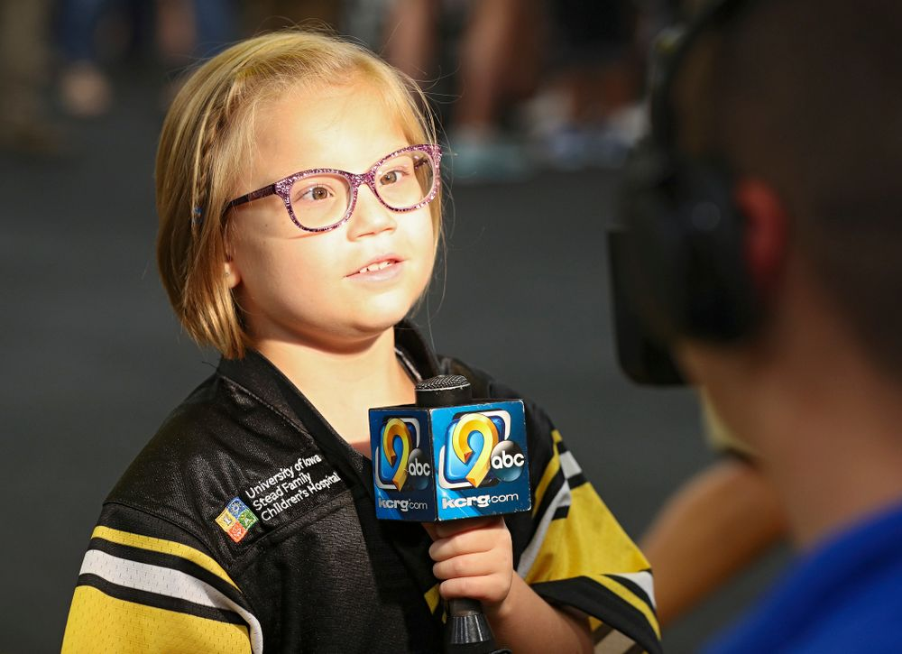 Kid Captain Gabby Yoder is interviewed in the Iowa locker room during Kids Day at Kinnick Stadium in Iowa City on Saturday, Aug 10, 2019. (Stephen Mally/hawkeyesports.com)