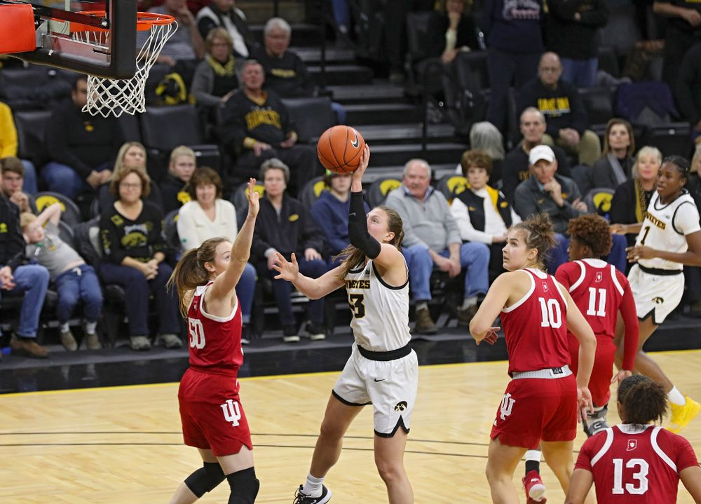 Iowa Hawkeyes forward Amanda Ollinger (43) makes a basket while being fouled during the third quarter of their game at Carver-Hawkeye Arena in Iowa City on Sunday, January 12, 2020. (Stephen Mally/hawkeyesports.com)