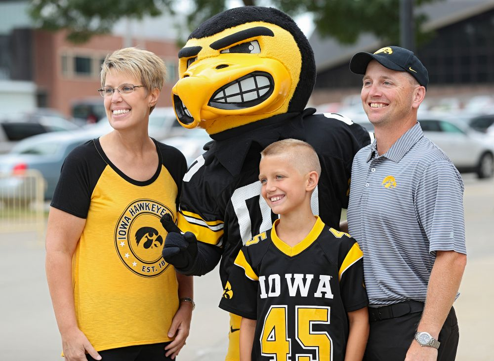 A family takes a picture with Herky during Kids Day at Kinnick Stadium in Iowa City on Saturday, Aug 10, 2019. (Stephen Mally/hawkeyesports.com)