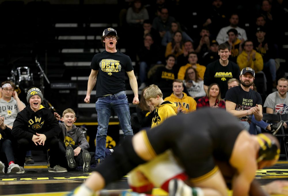 Fans cheer on Iowa's Alex Marinelli as he wrestles Nebraska's Isaiah White at 165 pounds Saturday, January 18, 2020 at Carver-Hawkeye Arena. Marinelli won the match 4-3. (Brian Ray/hawkeyesports.com)