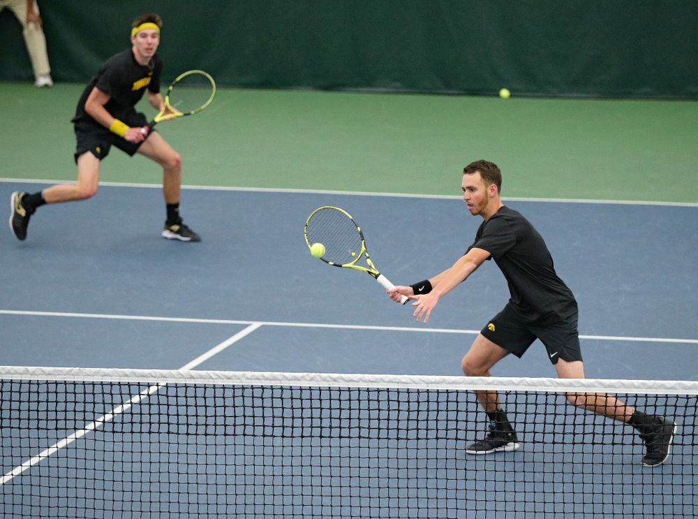 Iowa's Kareem Allaf (right) hits a shot as Nikita Snezhko looks on during their doubles match against Marquette at the Hawkeye Tennis and Recreation Complex in Iowa City on Saturday, January 25, 2020. (Stephen Mally/hawkeyesports.com)