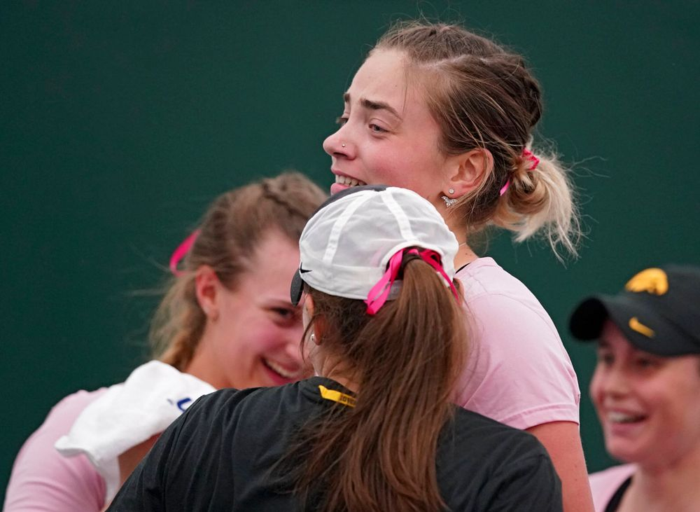 Iowa's Sophie Clark celebrates with teammates after winning her match against Purdue at the Hawkeye Tennis and Recreation Complex in Iowa City on Friday, Mar. 29, 2019. (Stephen Mally/hawkeyesports.com)
