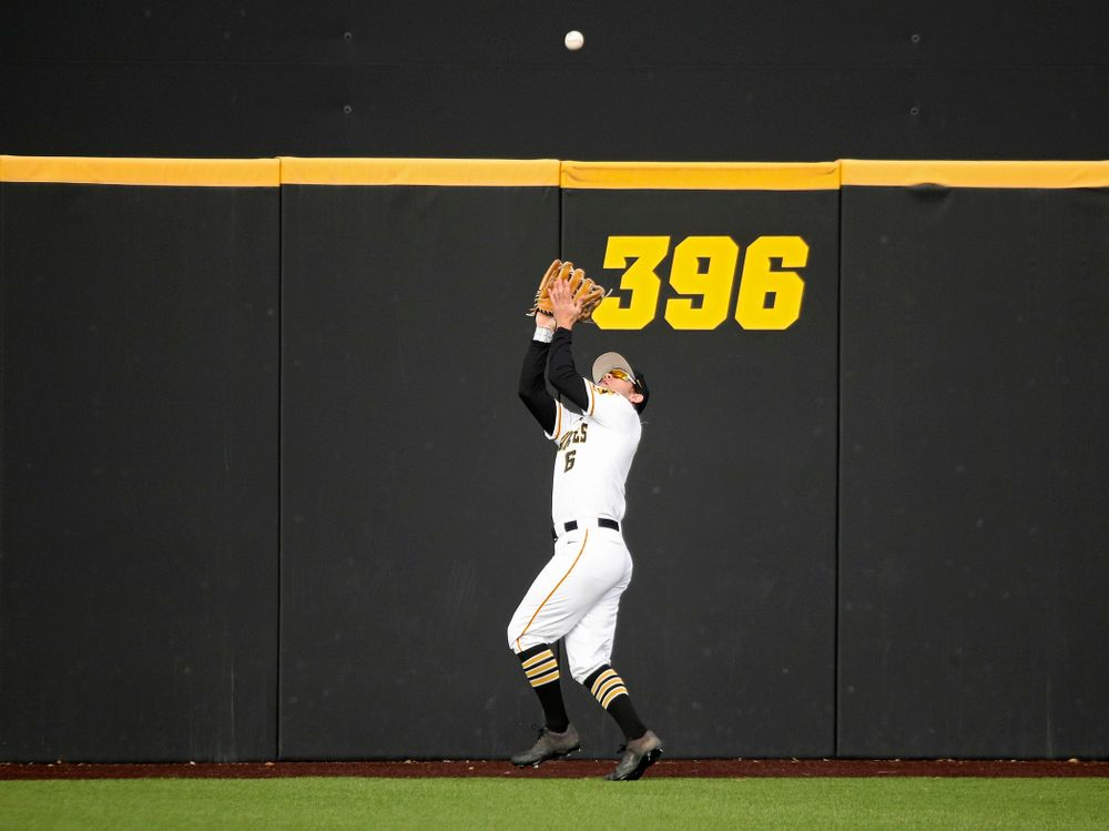 Iowa outfielder Justin Jenkins (6) runs down a fly ball for an out during the eighth inning of their college baseball game at Duane Banks Field in Iowa City on Wednesday, March 11, 2020. (Stephen Mally/hawkeyesports.com)