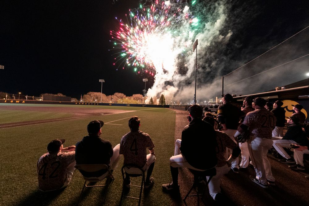The Iowa Hawkeyes watch the fireworks following their game against the Nebraska Cornhuskers on Military Appreciation Night Friday, April 19, 2019 at Duane Banks Field. (Brian Ray/hawkeyesports.com)