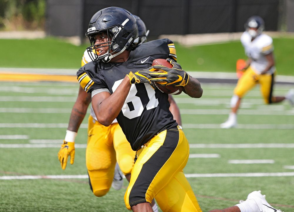 Iowa Hawkeyes wide receiver Desmond Hutson (81) runs after pulling in a pass during Fall Camp Practice No. 11 at the Hansen Football Performance Center in Iowa City on Wednesday, Aug 14, 2019. (Stephen Mally/hawkeyesports.com)