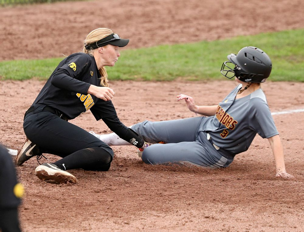 Iowa third basemans Ashley Hamilton (18) tags out a runner trying to steal during the fifth inning of their game against Iowa Softball vs Indian Hills Community College at Pearl Field in Iowa City on Sunday, Oct 6, 2019. (Stephen Mally/hawkeyesports.com)