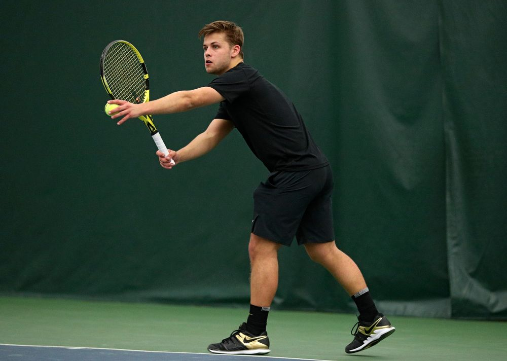 Iowa's Will Davies serves during his singles match at the Hawkeye Tennis and Recreation Complex in Iowa City on Friday, March 6, 2020. (Stephen Mally/hawkeyesports.com)