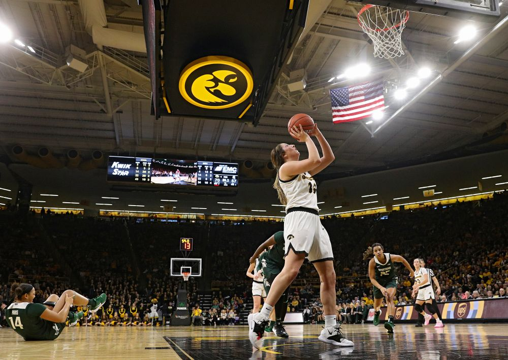 Iowa Hawkeyes guard Mckenna Warnock (14) makes a basket while being fouled during the fourth quarter of their game at Carver-Hawkeye Arena in Iowa City on Sunday, January 26, 2020. (Stephen Mally/hawkeyesports.com)