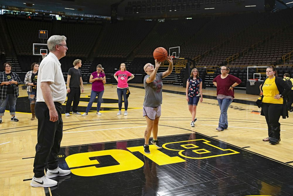 Iowa Hawkeyes head coach Fran McCaffery looks on as visitors from the University of Iowa Hospitals and Clinics Adolescent and Young Adult (AYA) Cancer Program shoot baskets at Carver-Hawkeye Arena in Iowa City on Monday, Sep 30, 2019. (Stephen Mally/hawkeyesports.com)
