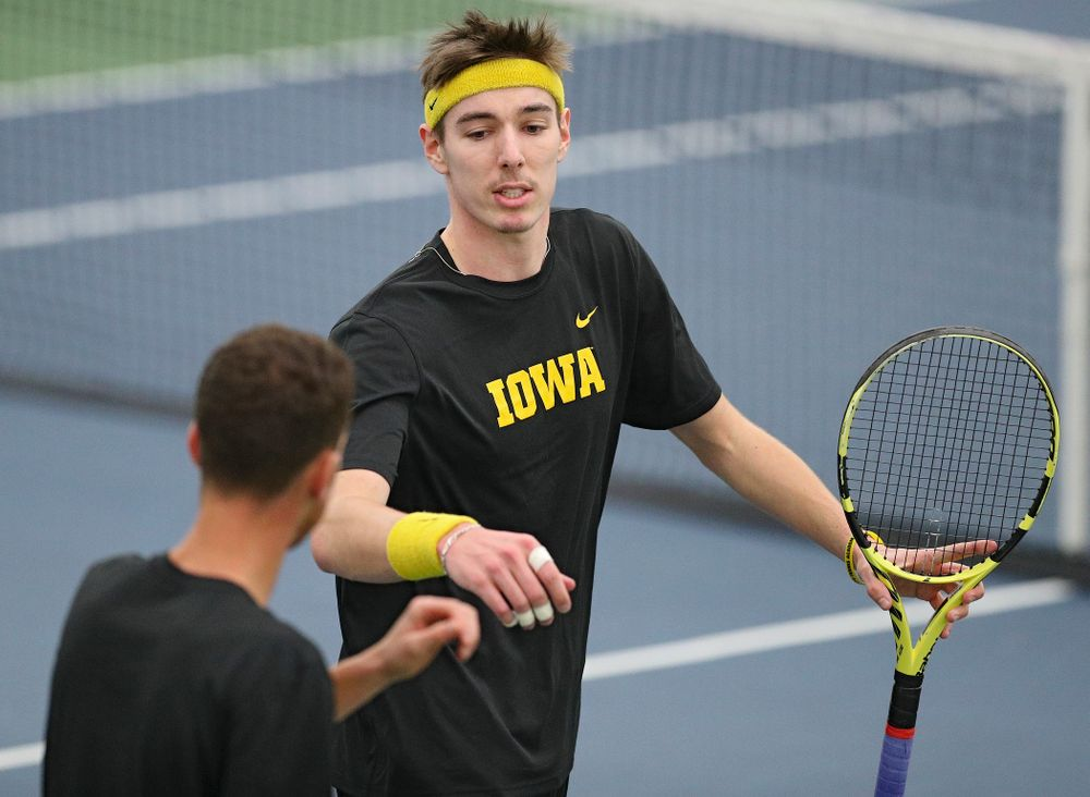 Iowa's Nikita Snezhko (right) and Kareem Allaf celebrate a point during their doubles match against Marquette at the Hawkeye Tennis and Recreation Complex in Iowa City on Saturday, January 25, 2020. (Stephen Mally/hawkeyesports.com)