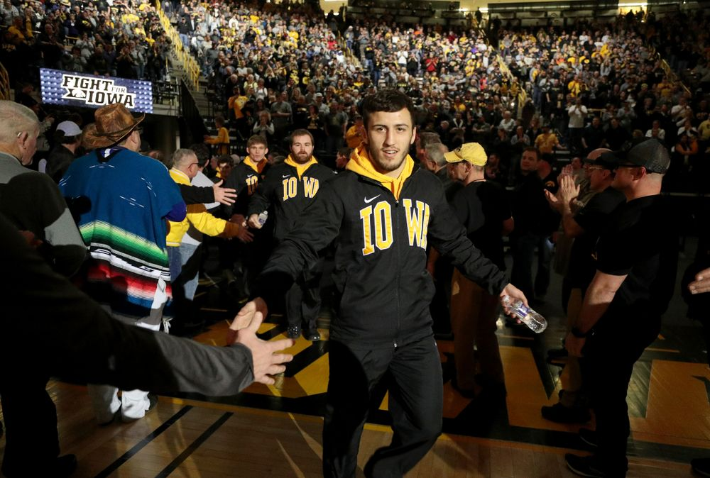 Michael Kemerer slaps hands in the alumni tunnel before the Iowa Hawkeyes meet against Oklahoma State's at pounds Sunday, February 23, 2020 at Carver-Hawkeye Arena. (Brian Ray/hawkeyesports.com)