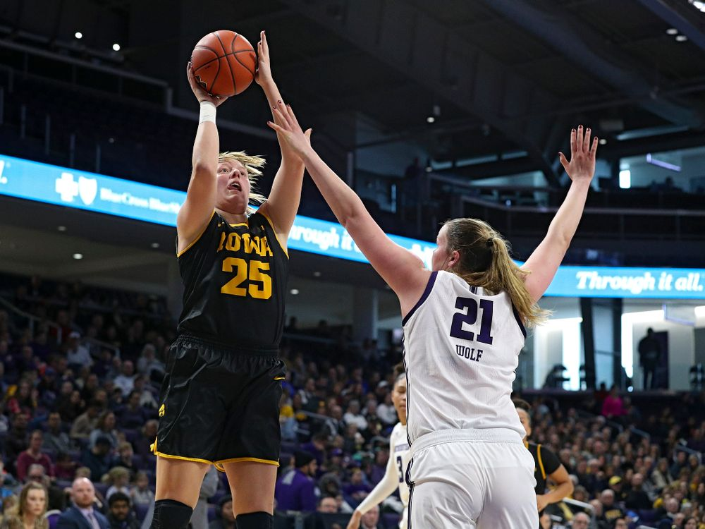 Iowa Hawkeyes forward Monika Czinano (25) makes a basket during the second quarter of their game at Welsh-Ryan Arena in Evanston, Ill. on Sunday, January 5, 2020. (Stephen Mally/hawkeyesports.com)
