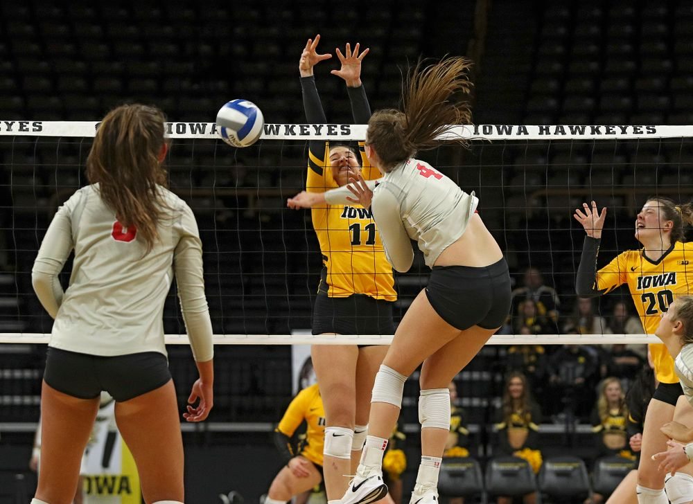 Iowa's Blythe Rients (11) blocks a shot during the first set of their match at Carver-Hawkeye Arena in Iowa City on Friday, Nov 29, 2019. (Stephen Mally/hawkeyesports.com)