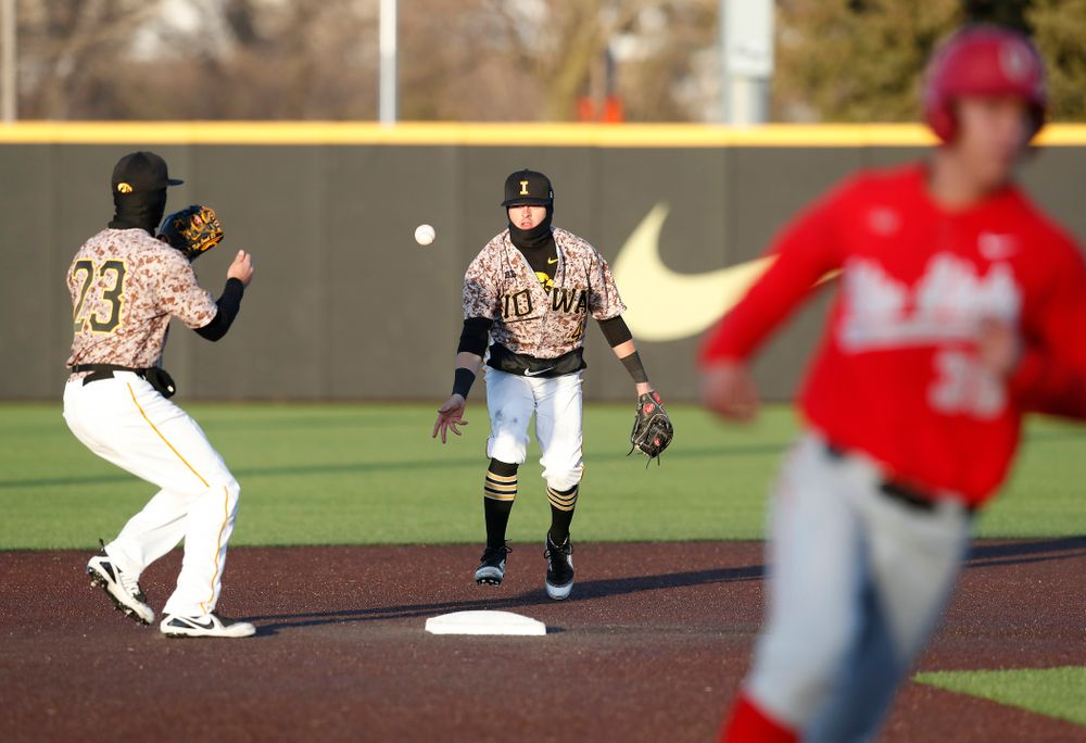 Iowa Hawkeyes infielder Mitchell Boe (4) and infielder Kyle Crowl (23) against the Ohio State Buckeyes Saturday, April 7, 2018 at Duane Banks Field. (Brian Ray/hawkeyesports.com)