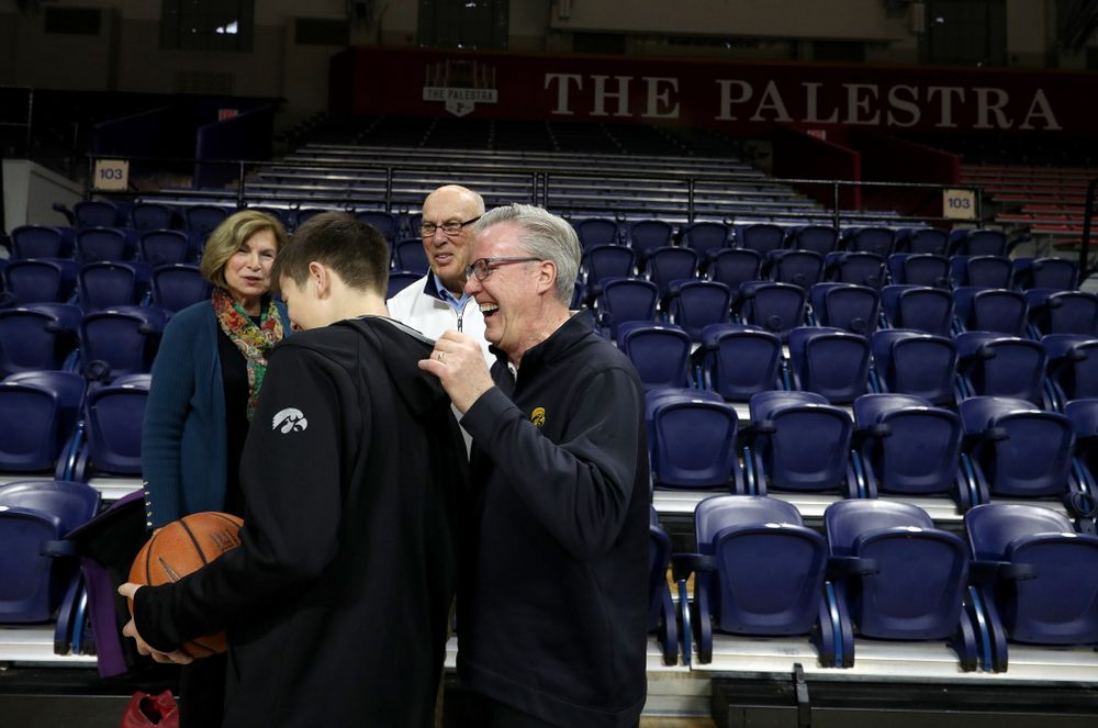 Iowa Hawkeyes head coach Fran McCaffery introduces his son Jack to  Bob Weinhauer, his head coach from Penn, before practice at the Palestra Friday, January 3, 2020 in Philadelphia. (Brian Ray/hawkeyesports.com)