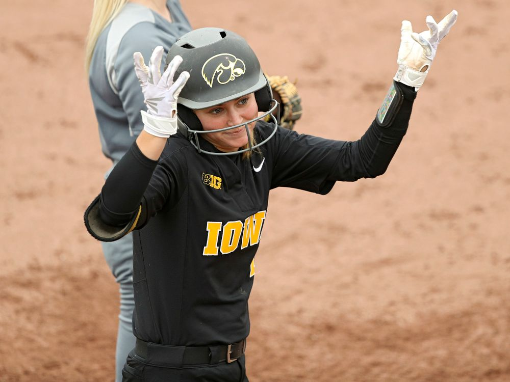 Iowa's Aralee Bogar (2) shrugs her shoulders after driving in two runs with a hit during the fourth inning of their game against Iowa Softball vs Indian Hills Community College at Pearl Field in Iowa City on Sunday, Oct 6, 2019. (Stephen Mally/hawkeyesports.com)