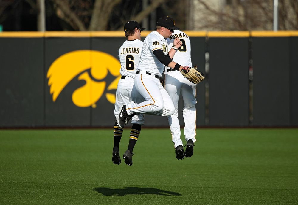 Iowa outfielders Justin Jenkins (6), Zeb Adreon (5), and Ben Norman (9) celebrate after winning their college baseball game at Duane Banks Field in Iowa City on Wednesday, March 11, 2020. (Stephen Mally/hawkeyesports.com)