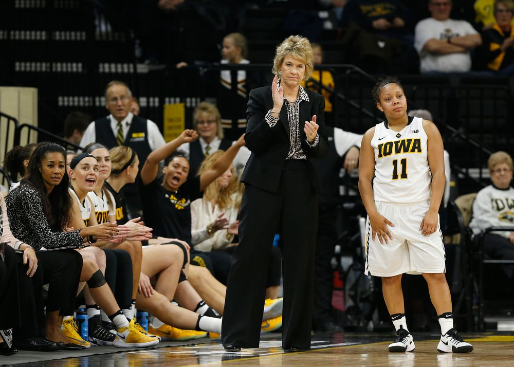 Tania Davis (11), Head coach Lisa Bluder
