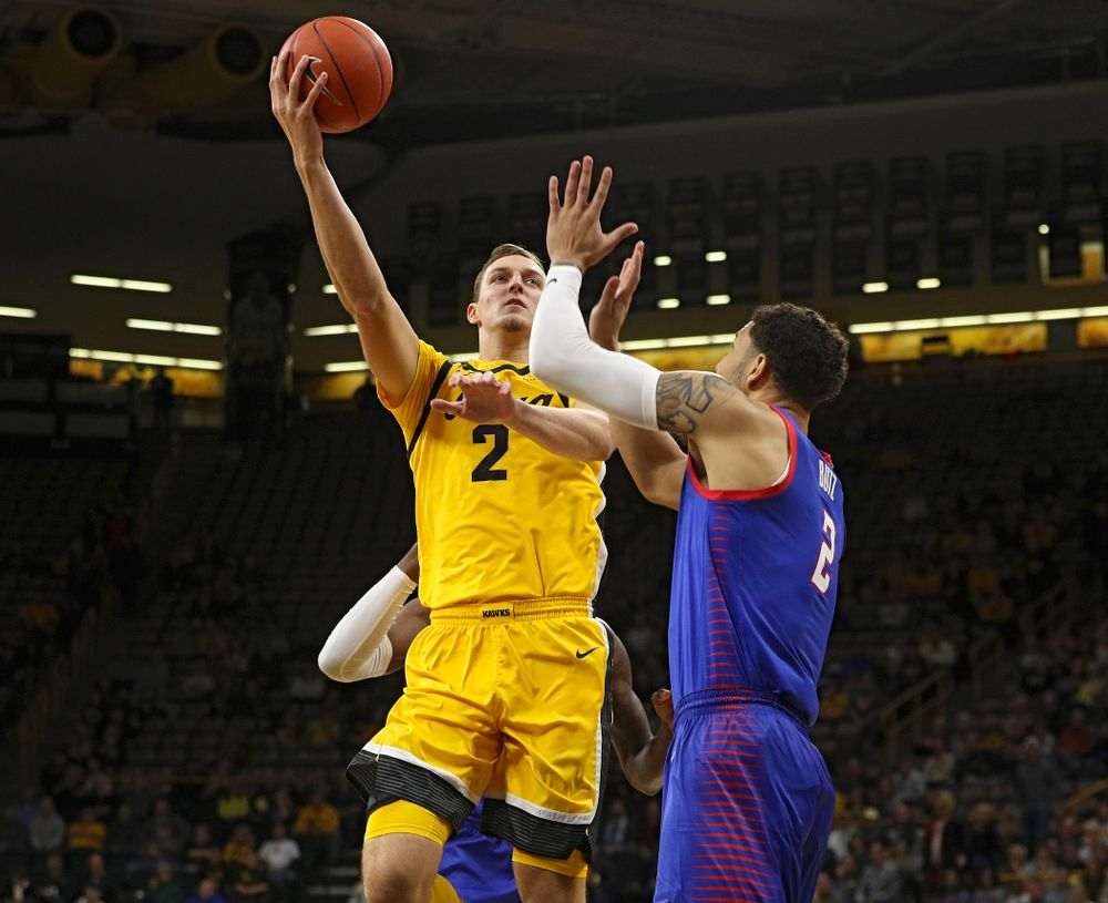 Iowa Hawkeyes forward Jack Nunge (2) puts up a shot during the first half of their game at Carver-Hawkeye Arena in Iowa City on Monday, Nov 11, 2019. (Stephen Mally/hawkeyesports.com)