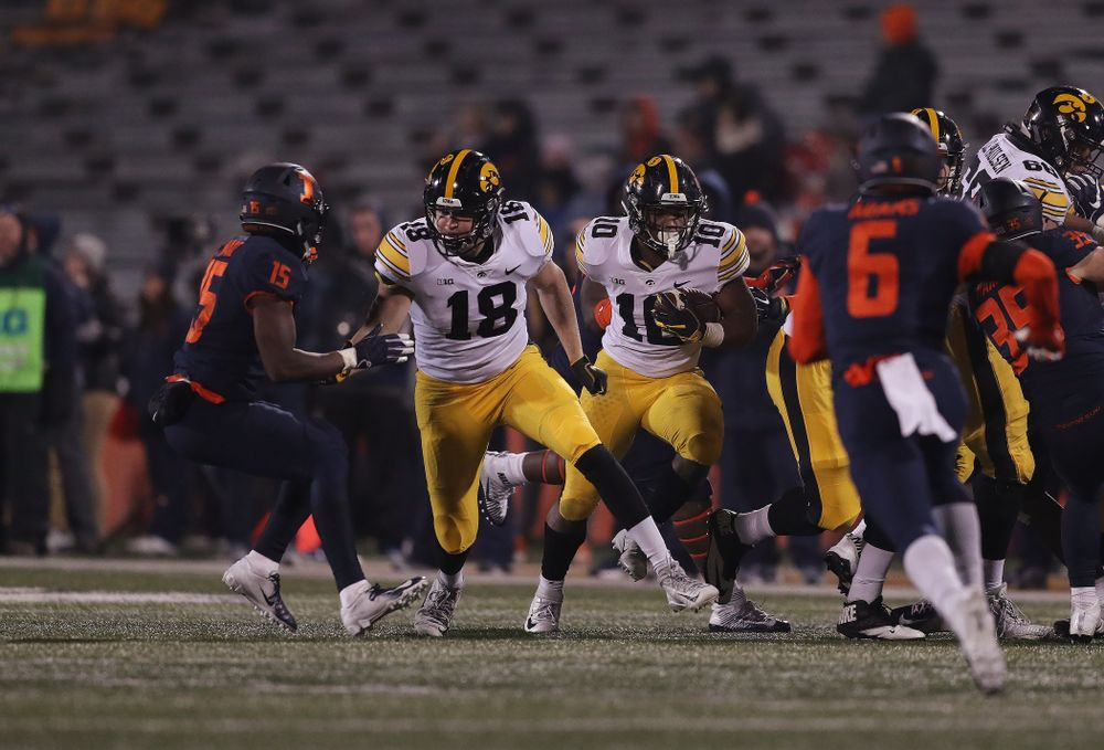 Iowa Hawkeyes running back Mekhi Sargent (10) runs behind tight end Drew Cook (18) against the Illinois Fighting Illini Saturday, November 17, 2018 at Memorial Stadium in Champaign, Ill. (Brian Ray/hawkeyesports.com)