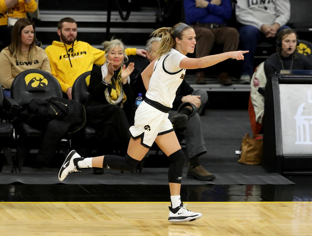 Iowa Hawkeyes guard Makenzie Meyer (3) celebrates after making a three point basket on an assistant from guard Megan Meyer (11) against North Carolina Central Saturday, December 14, 2019 at Carver-Hawkeye Arena. (Brian Ray/hawkeyesports.com)
