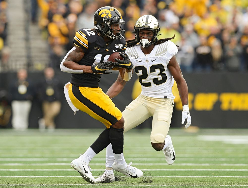 Iowa Hawkeyes wide receiver Brandon Smith (12) makes a catch during the first quarter of their game at Kinnick Stadium in Iowa City on Saturday, Oct 19, 2019. (Stephen Mally/hawkeyesports.com)